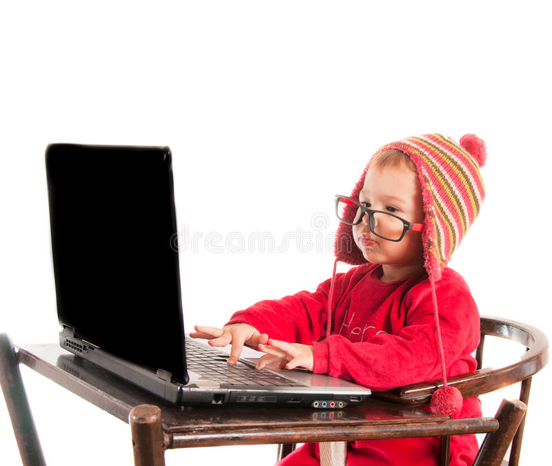 Baby hacker. Little baby hacker typing on the laptop computer,isolated on white royalty free stock photos