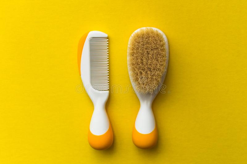 Baby hair brush on yellow background stock photography