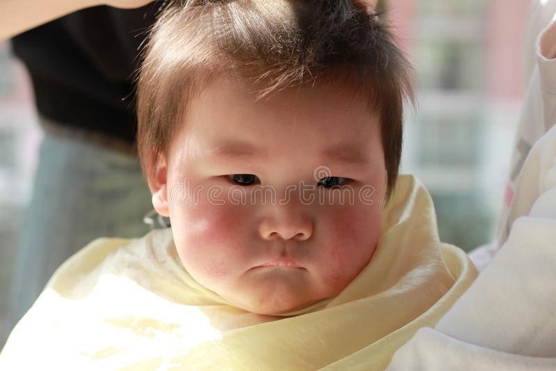 Baby haircut stock image