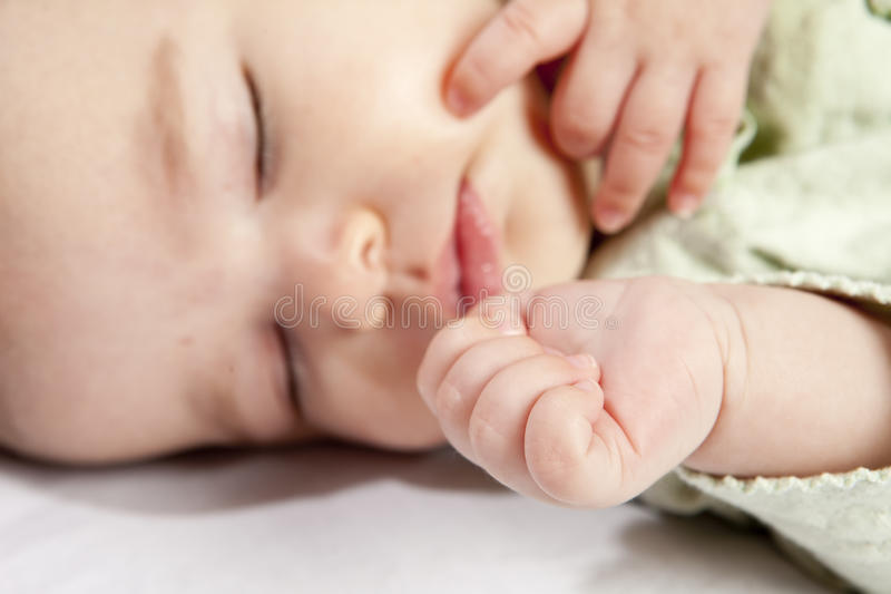 Download Baby and hand stock photo. Image of focus, face, person - 12359458