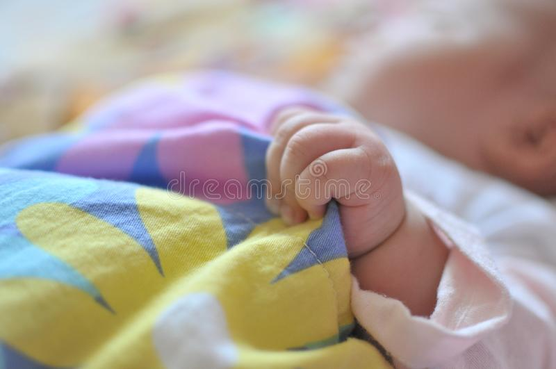 Baby hand close up,Grabbing the quilt royalty free stock photography