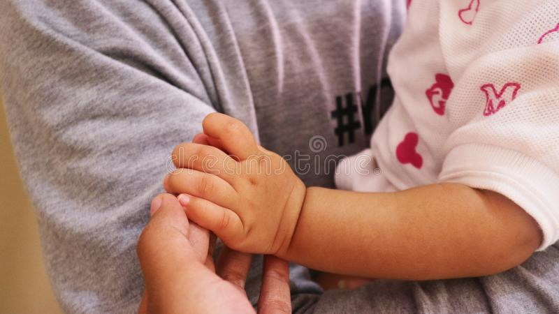 Baby Hand Holded. Baby hand is holded and she was in arm royalty free stock photo