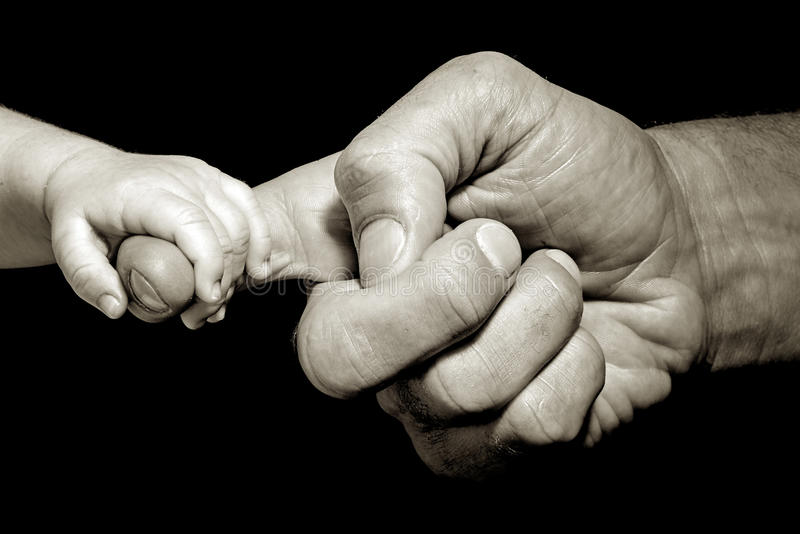 Baby hand holding stock photography