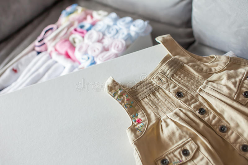 Baby handkerchiefs with BB dress. Are tidy in the white gift box stock image