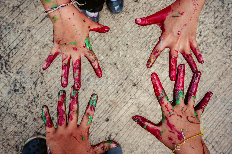Baby hands smeared with paint stock photo