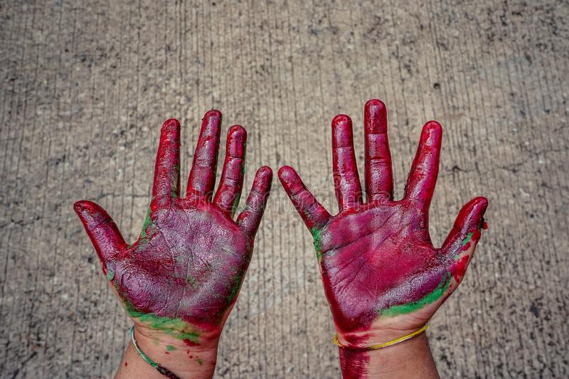 Baby hands smeared with paint stock image