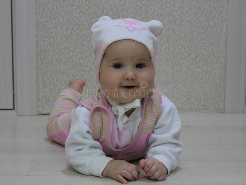 Baby in a hat with a bear royalty free stock photography