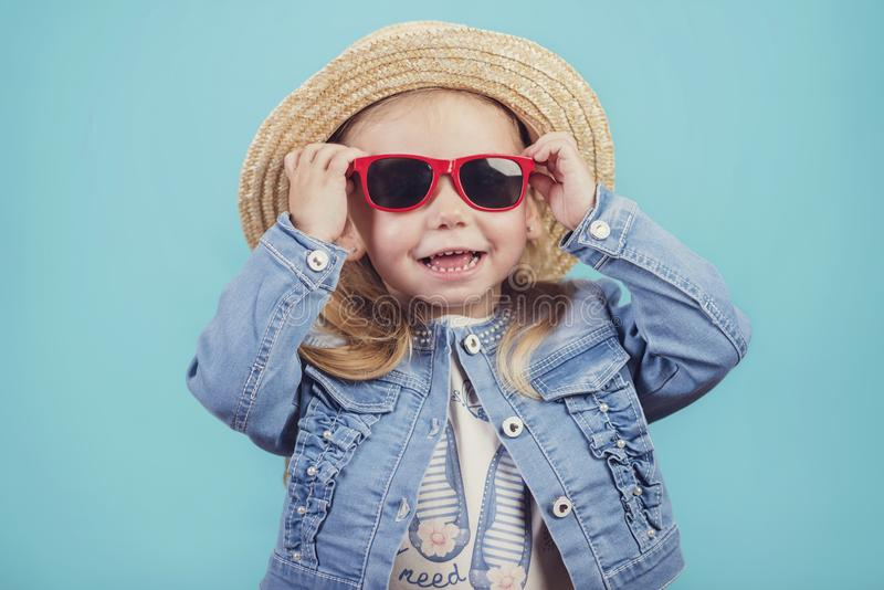 Baby with hat and sunglasses royalty free stock photo