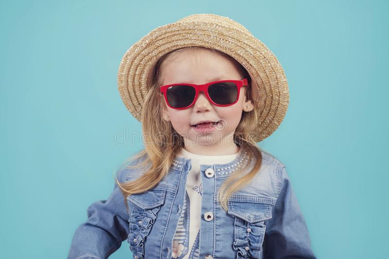 Baby with hat and sunglasses stock photos