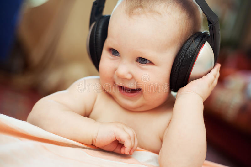 Baby with headphone. Smiling baby girl with headphone royalty free stock photos