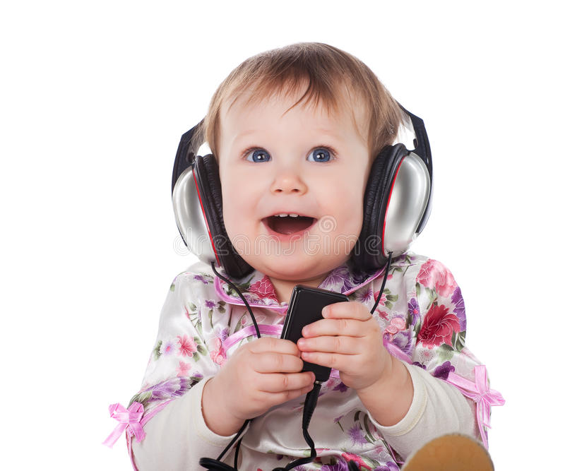 Baby with headphone. Smiling baby with headphone isolated stock photo