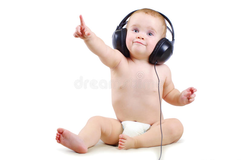 Baby with headphone. Smiling baby with headphone over white background stock photography