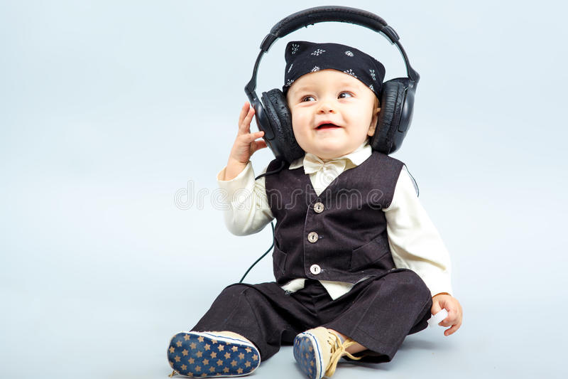 Baby with headphone. The beautiful baby with headphone, boy royalty free stock image