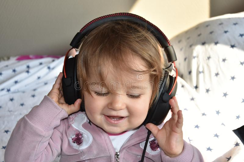 Baby with headphone. young DJ stock images