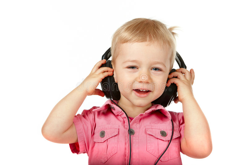Baby with headphones stock image