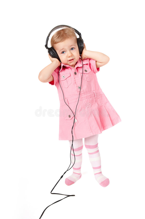 Baby with headphones royalty free stock photo