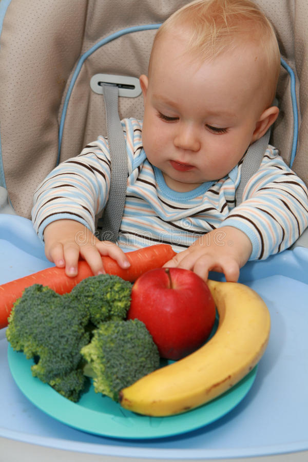 Baby and healthy food royalty free stock photo