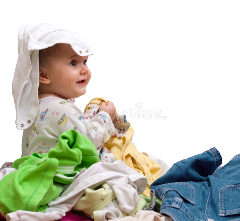 Baby In Heap Of Wear Royalty Free Stock Images