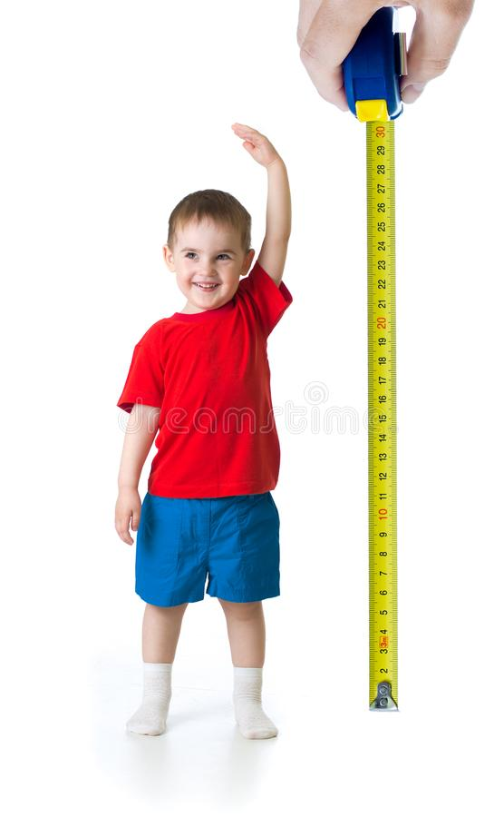 Kid growing measuring with ruler royalty free stock photos