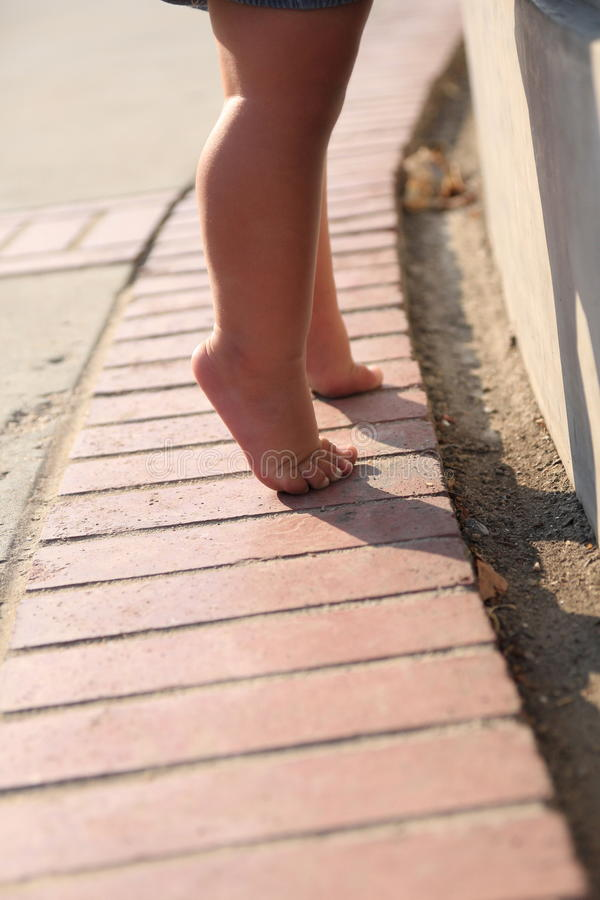 Baby on her tippy toes. Image of baby legs from the knee down royalty free stock photography