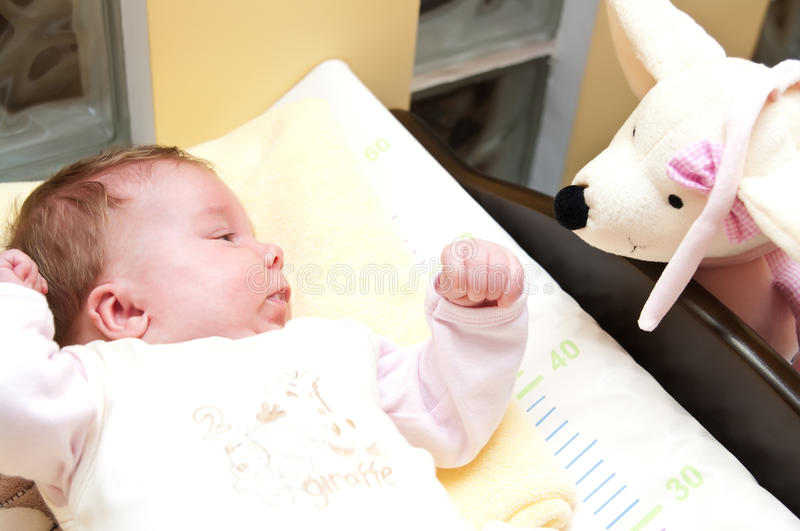 Download Baby with her toy friend stock image. Image of look, soft - 14395505