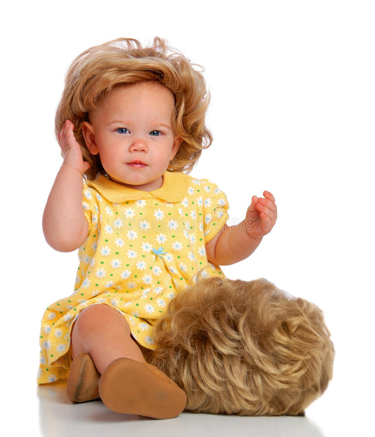 Baby And Her Wig stock photography