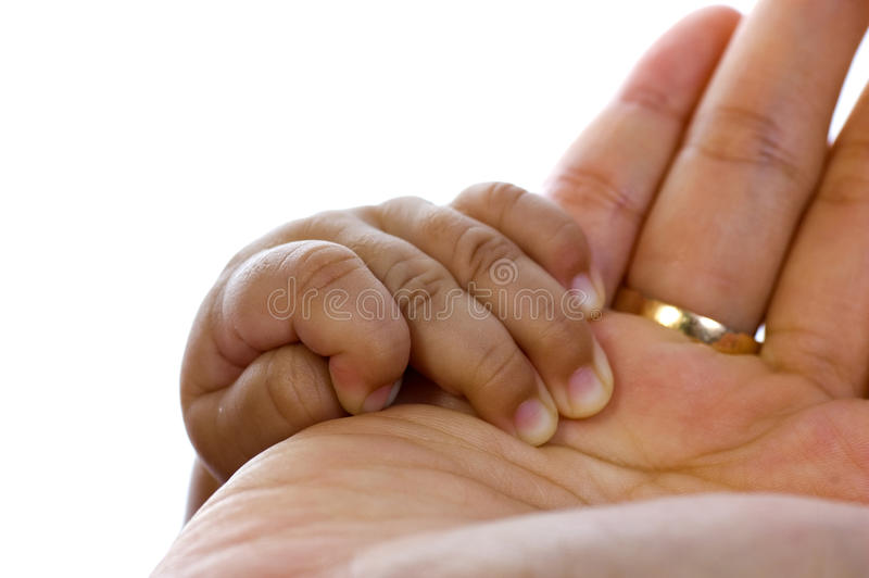 Baby hold mother's hand stock photos