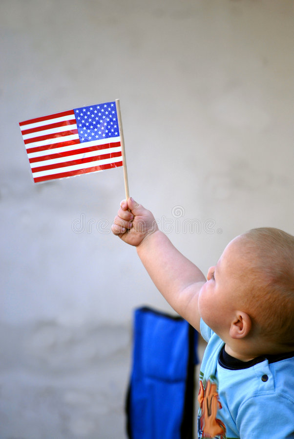 Baby Holding American Flag. Little Baby Holding American Flag royalty free stock photography