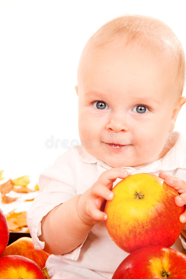 Baby holding apples in hands stock photos