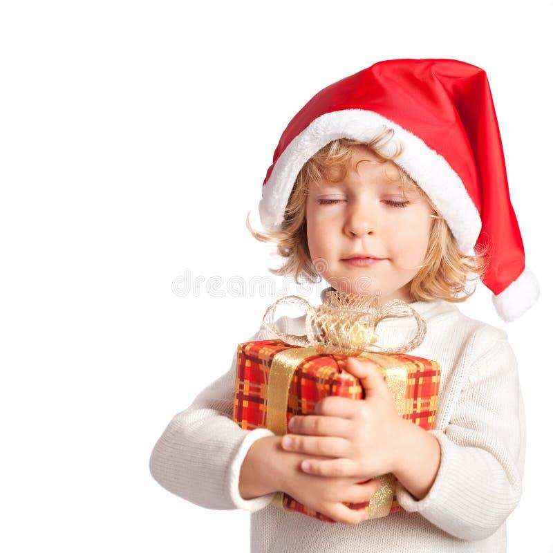 Baby holding Christmas gift stock photos