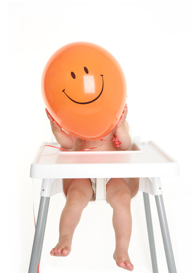 Baby holding happy balloon stock images