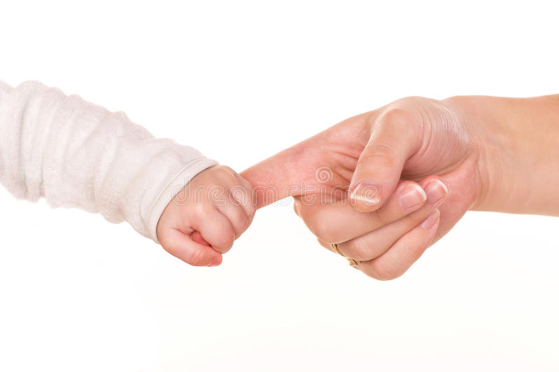 Baby holds mother's finger, trust family help concept. Isolated on white background stock photos