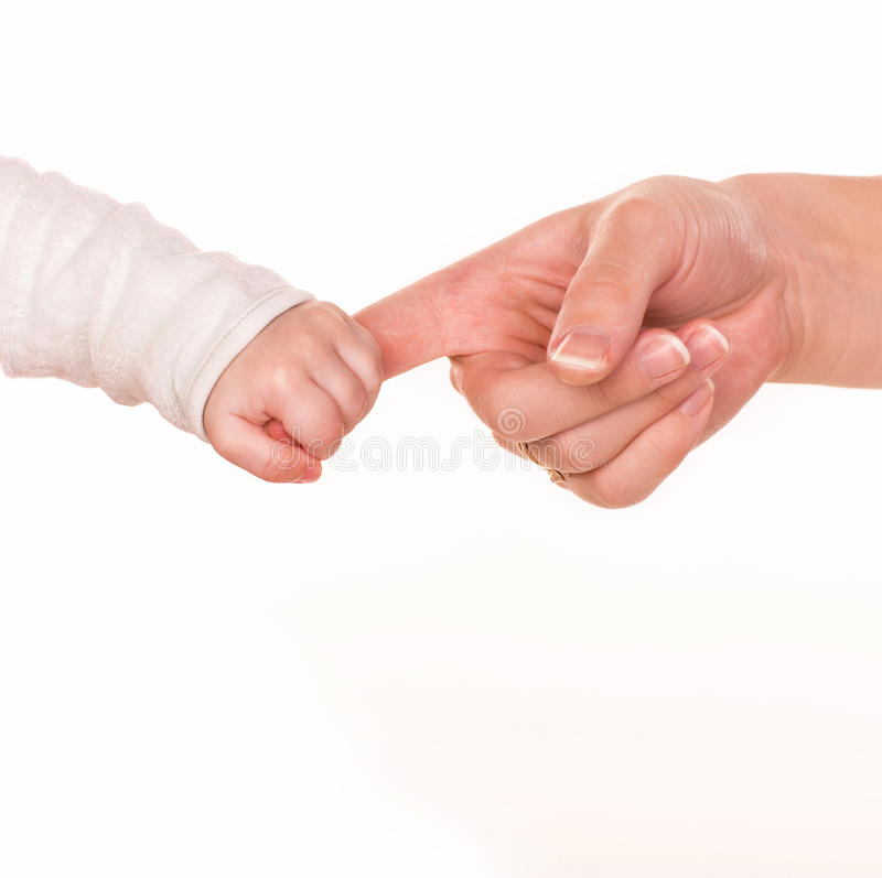 Baby holds mother's finger, trust family help concept. Isolated on white background royalty free stock images