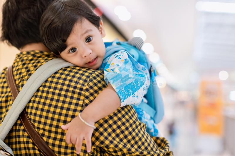 Baby hugging mother. Mother is holding her little baby boy. stock photo