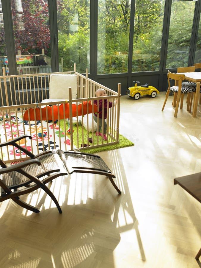 Free Baby In Playpen In Living Room Stock Image - 12021431