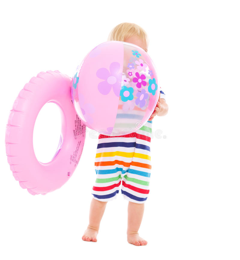 Download Baby With Inflatable Ring Hiding Behind Ball Stock Photo - Image: 25702602