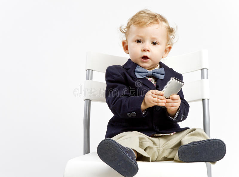 Baby in jacket and bow tie royalty free stock photography