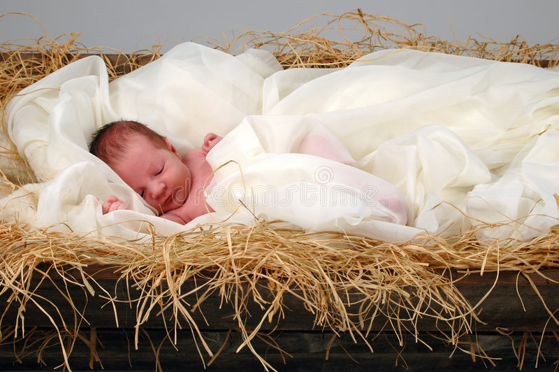 Baby Jesus in Manger. The Christmas story with baby Jesus sleeping in manger
