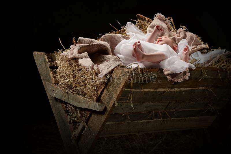 Baby Jesus on a Manger. First Christmas day with Jesus on a manger stock photos