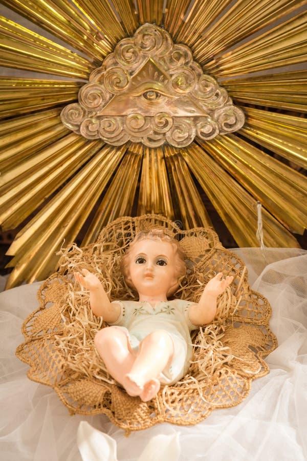 Baby Jesus in seiner Krippe lizenzfreie stockbilder