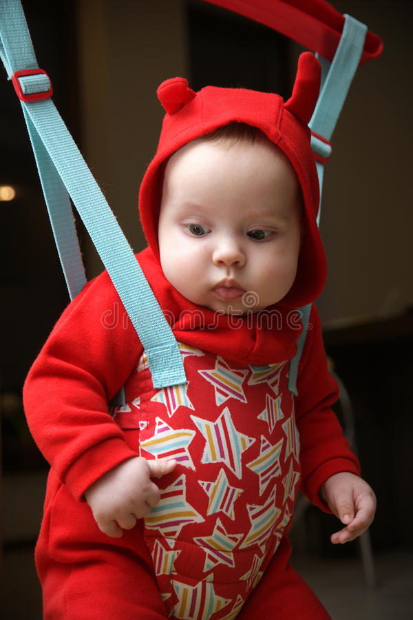 Baby in the jumper. Dressed in red clothes royalty free stock image