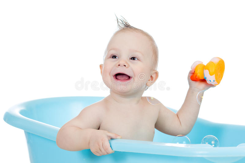 Baby kid boy taking bath and playing with toy royalty free stock photos