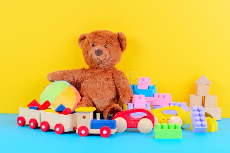 Baby kid toys collection on blue and yellow background royalty free stock photo
