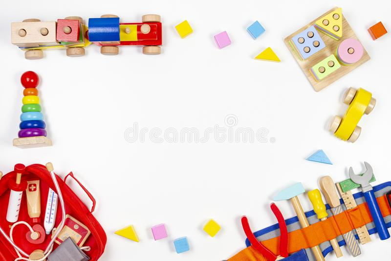 Baby kids toys background. Wooden educational toys, train, rainbow, airplane, blocks, construction tools and set of toy royalty free stock photos