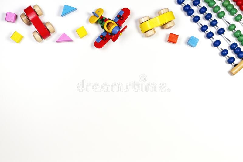 Baby kids toys frame on white background. Top view, flat lay. Copy space for text. Baby kids toys frame on white background. Top view. Flat lay. Copy space for stock photos