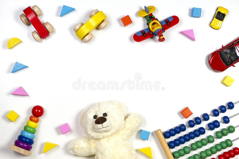 Baby kids toys frame on white background. Top view, flat lay. Copy space for text. Baby kids toys frame on white background. Top view. Flat lay. Copy space for royalty free stock photo