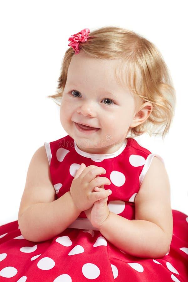 Baby klatscht ihre Hände stockfotografie