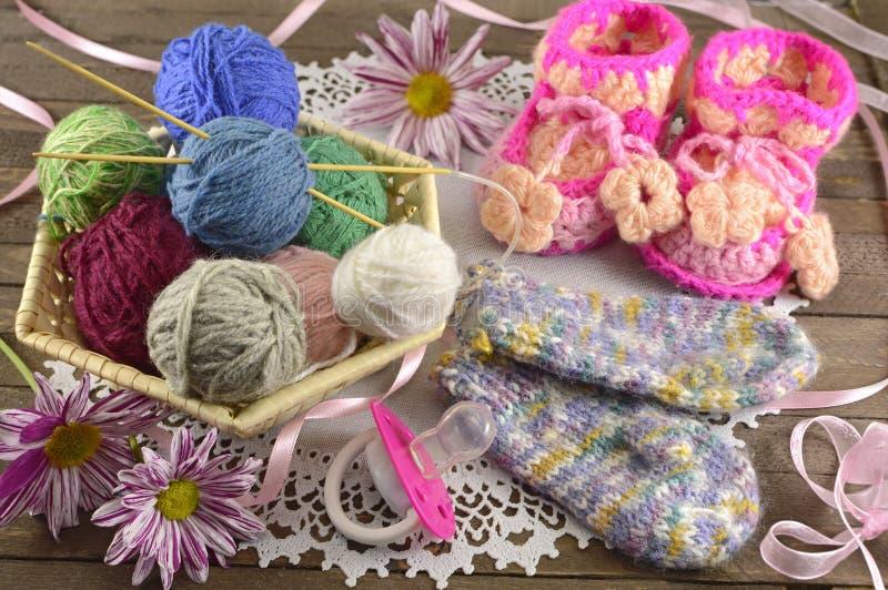 Baby knitting things stock photos