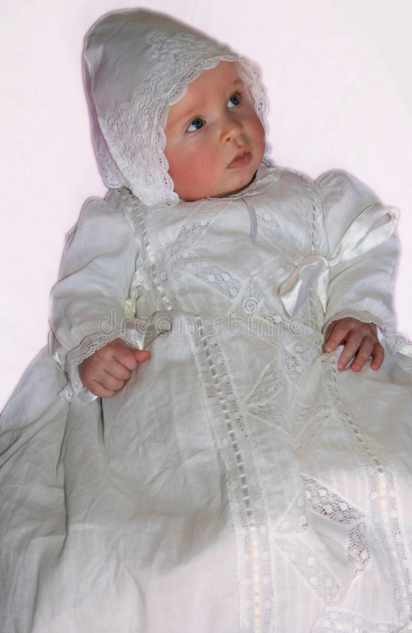 Baby in a lace gown stock photography