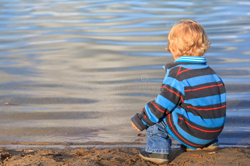 Download Baby on the lake stock photo. Image of outside, sitting - 25573100